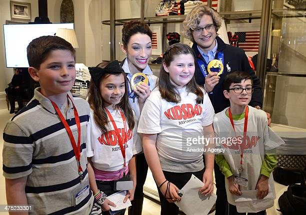 Olympic figure skating gold medalists Meryl Davis and Charlie White pose to media with their fans during the signing ceremony in New York on February...