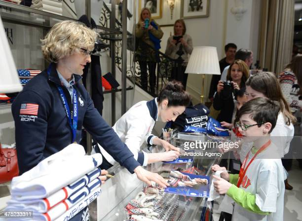 Olympic figure skating gold medalists Meryl Davis and Charlie White talk to fans while signing autographs in New York on February 26, 2014.