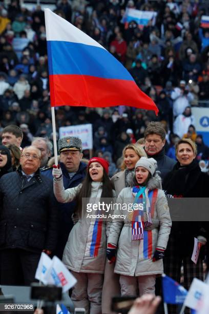 Olympic figure skating silver medallist Yevgenia Medvedeva and Olympic figure skating silver medallist Alina Zagitova attend a rally in support of...