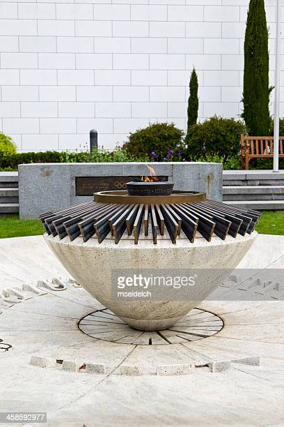 olympic fire at headquarter of the ioc, lausanne, switzerland - lausanne stock pictures, royalty-free photos & images