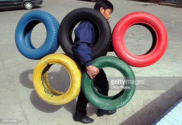 Olympic Five Rings Symbol Decoration At A Car Washing Shop