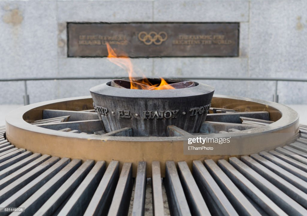 Olympic flame burning outside the Olympic museum at Lausanne, Switzerland : Stock Photo