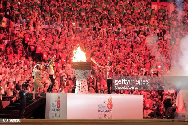 Olympic flame is being lit during the opening ceremony of Deaflympics at 19 Mayis Stadium in Samsun Turkey on July 18 2017 Samsun will be hosting...