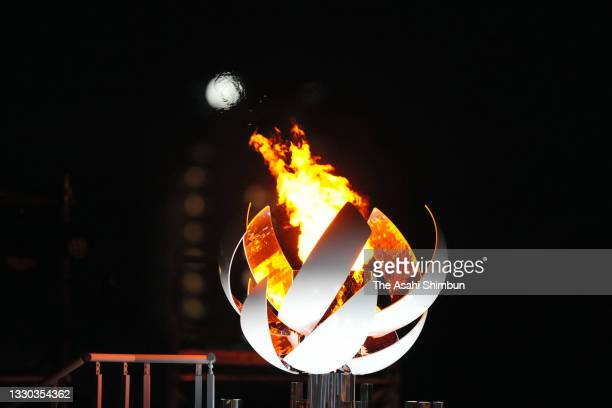 Olympic Flame is lit at the second cauldron at Yume-no-Ohashi Bridge on July 24, 2021 in Tokyo, Japan.
