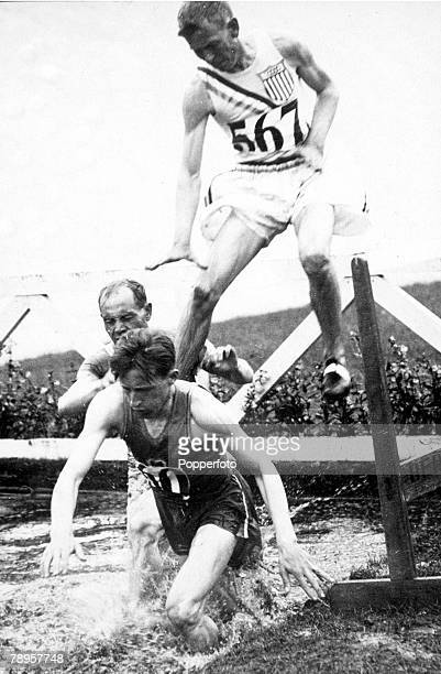 Olympic Games, Amsterdam, Holland, 3000 Metres Steeplechase Heat 2, France's L Dunquesne leads from Finland's Paavo Nurmi and Spencer