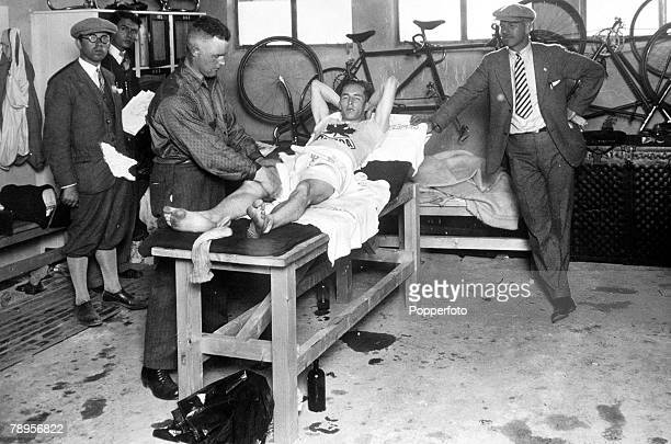 Olympic Games Amsterdam Holland Canada's Percy Williams receives a massage from trainer Bob Grainger