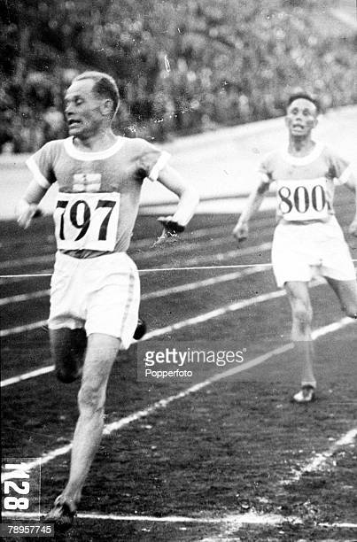 Olympic Games, Amsterdam, Holland, Men's 10000 Metres Final, Finland's Paavo Nurmi finishes the race to take the gold followed by fellow countryman...
