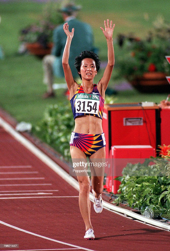 1996 Olympic Games. Atlanta, USA. Athletics. Women's 5000 Metres Final. China's Junxia Wang celebrates as she crosses the line to win the gold medal. : News Photo