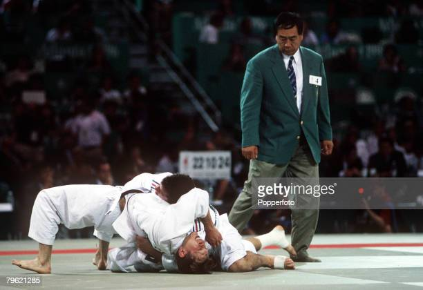 Olympic Games, Atlanta, USA, Men's Judo,Two fighters wrestle during their bout watched by the referee