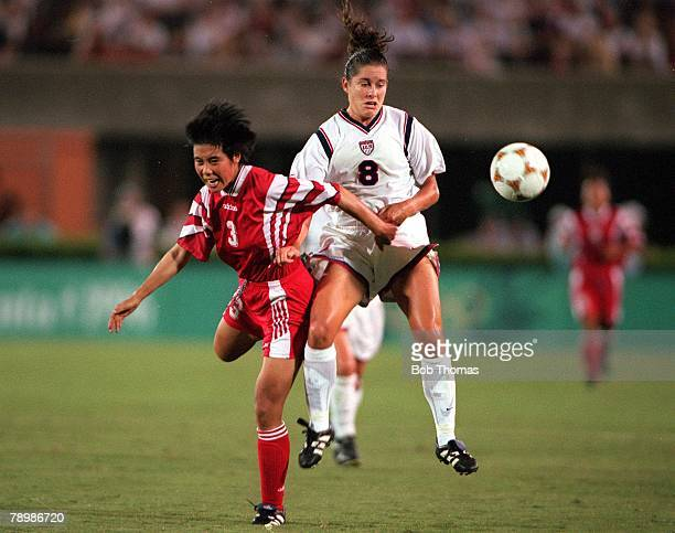 Olympic Games Atlanta USA Sanford Stadium Georgia Women's Football Gold Medal Match USA 2 v China 1 USAs Shannon MacMillan clashes for the ball with...
