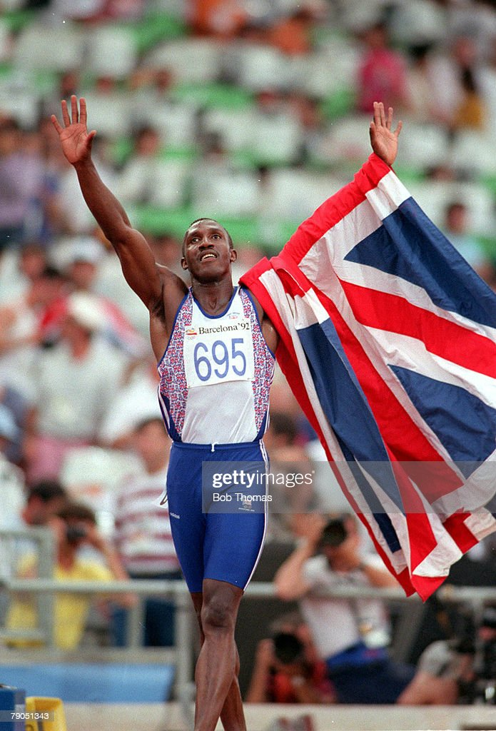 Olympic Games, Barcelona, Spain, 100m Final, Linford Christie of Great Britain holds a Union Jack Flag as he salutes his fans after winning the 100m Gold medal