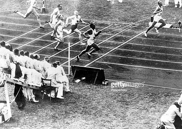 Olympic Games Berlin Germany 3rd August 1936 Men's 100 Metres Final USA's Jesse Owens wins the race from Ralph Metcalfe and Dutchman Martinus...