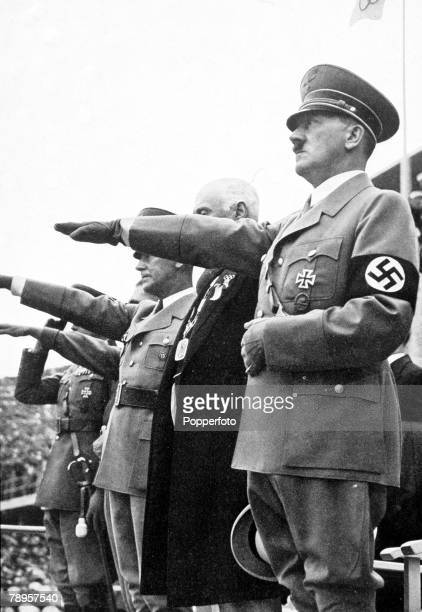 Olympic Games, Berlin, Germany, German Chancellor Adolf Hitler and other officials give the Nazi salute in the stadium