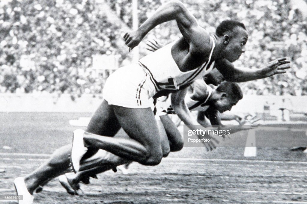 1936 Olympic Games. Berlin, Germany. Men's 100 Metres Final. USA's legendary Jesse Owens on his way to winning one of his four gold medals. : News Photo