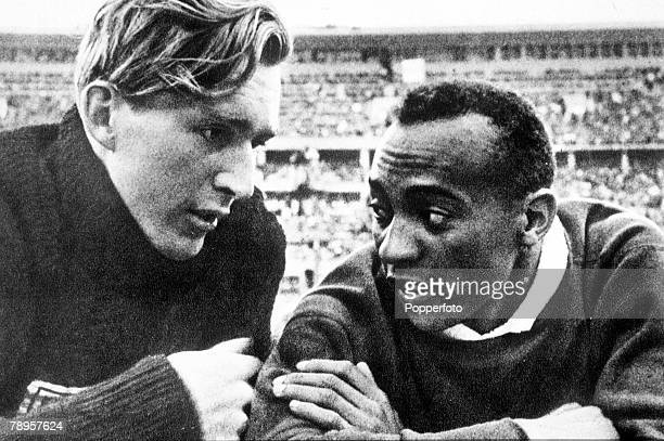Olympic Games Berlin Germany Men's Long Jump USA's goldmedalist Jesse Owens talks to German silver medallist Luz Long