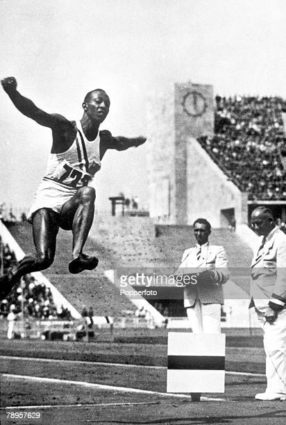 Olympic Games Berlin Germany Men's Long Jump USA's legendary Jesse Owens in action to win the gold medal