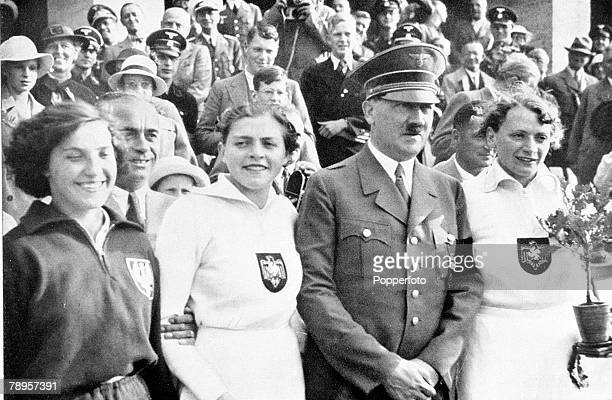 Olympic Games Berlin Germany Women's Javelin Nazi leader Adolf Hitler with Germany's gold medal winner Tilly Fleischer and silver medallist Louise...