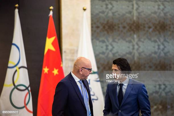 Olympic Games Executive Director Christophe Dubi talks with IOC Coordination Commission member abd IBSF President Ivo Ferriani piror to the planery...
