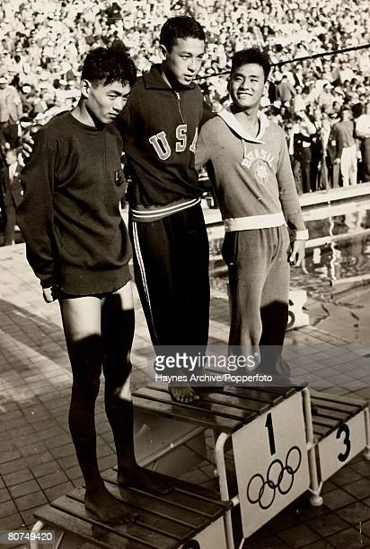 1952 Olympic Games Helsinki Finland Mens 1500 metres Swimming A picture on the rostrum of the medal winners first Konna Gold second Shiro Hashizume...