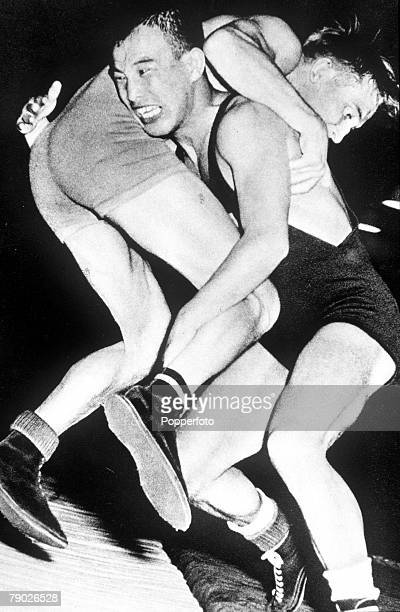 Olympic Games, Helsinki, Finland, Weightlifing, Bantamweight, Japan's Shohachi Ishii who won the gold medal in action against Sweden's Vesterby