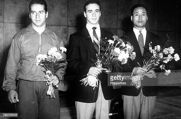 Olympic Games Helsinki Finland Weightlifting Middleweight Pictured from left to right Silver Medal winner Gerard Gratton of Canada Gold Medal Winner...