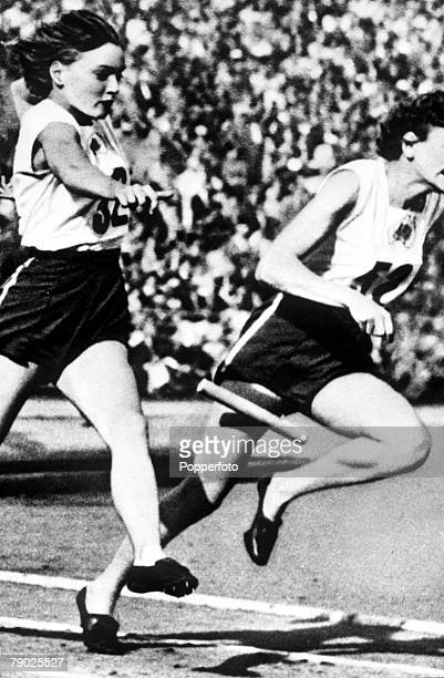 Olympic Games Helsinki Finland Womens 4x100 metre Relay Winner of both individual sprints Marjorie Jackson of Australia drops the baton on a...
