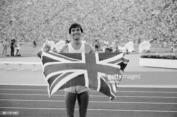 Olympic Games in Los Angeles USA Mens Athletics Great Britain's Sebastian Coe celebrates with thte Union Jack flag after winning the gold medal in...