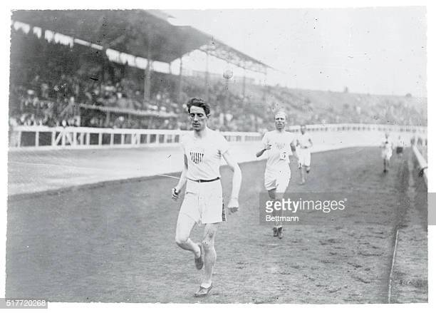 Olympic Games London England 1908 1500 meter flat race 1st heat J Sullivan USA 1st and JD Lightbody USA 2nd