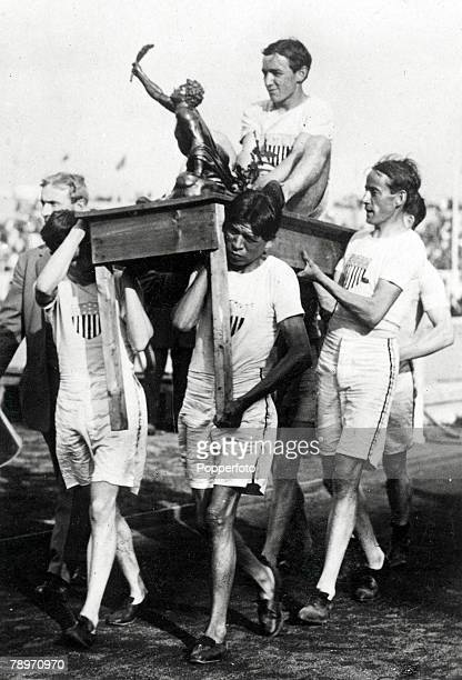 Olympic Games, London, England, Athletics, John, J, Hayes of USA is lifted on a table by his team-mates as he celebrates after winning the Marathon