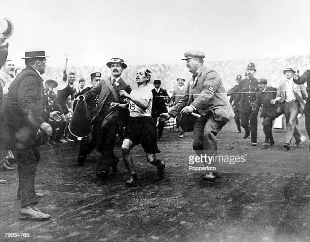 Olympic Games, London, England, Italian runner Dorando Pietri runs towards the tape in the Marathon of the 1908 Games, After the 26 miles miles from...