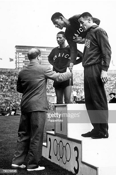 Olympic Games London England Men's 400 Metres Jamaica's Arthur Wint receives the gold medal on the podium after the race with Jamaica's Herb McKenley...