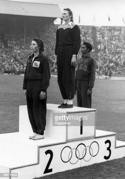 Olympic Games London England Women's 200 Metres Final Holland's Fanny BlankersKoen stands on the podium after winning the gold medal along with Great...