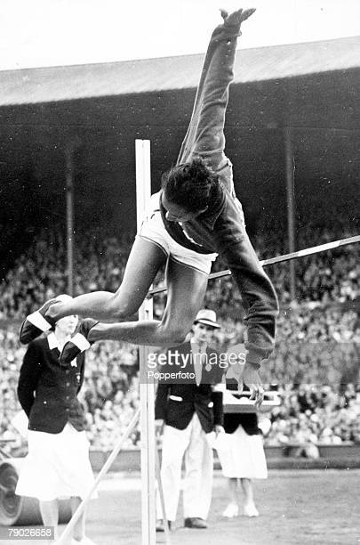 Olympic Games London England Women's High Jump USA's Alice Coachman in action to win the gold medal with a new Olympic record jump