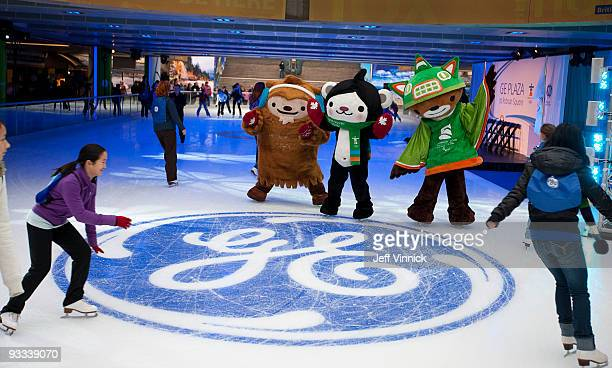Olympic Games mascots Quatchi Miga and Sumi look on as members of the public skate during the official opening of the GE Ice Plaza November 23 2009...