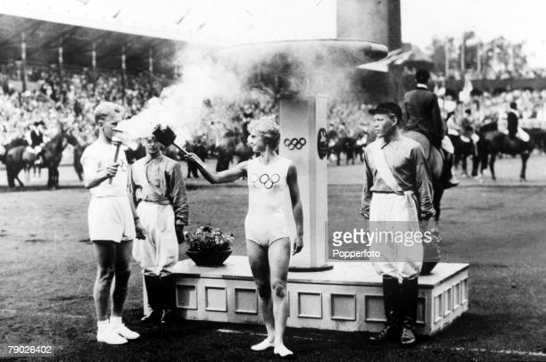 Olympic Games Melbourne Australia Henry Eriksson lights a torch held by Karin Lindborg at the Opening ceremony of the Equestrian games which were...