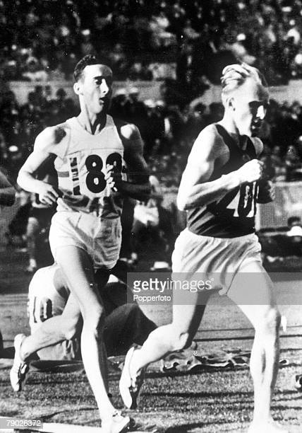 Olympic Games Melbourne Australia Men's 5000 Metres USSR's Vladimir Kuts in action to win the gold medal in front of Great Britain's Gordon Pirie who...