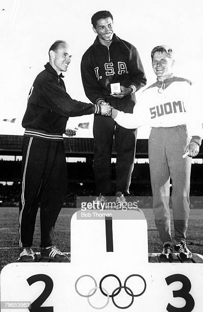 Olympic Games Melbourne Australia Mens Long Jump Gold Medal winner Gregory Bell from USA stands on the podium with USA's Silver Medal winner John...