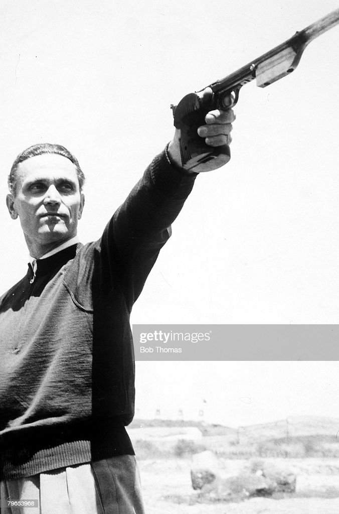 1956 Olympic Games, Melbourne, Australia, Rapid-Fire Pistol Shooting, Silhouette, Hungary's Karoly Takacs, the Gold Medal winner in 1948 and 1952, shoots left-handed, Takacs finished in 8th place : News Photo