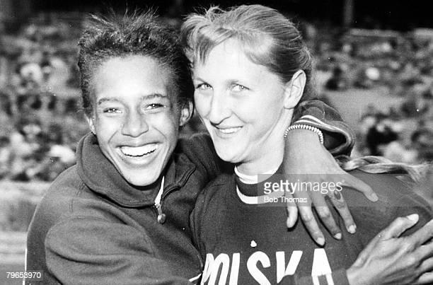 Olympic Games, Melbourne, Australia, Womens Long Jump, Poland's Gold Medal winner Elzibeta Krzesinska is hugged by America's Silver Medal winner...