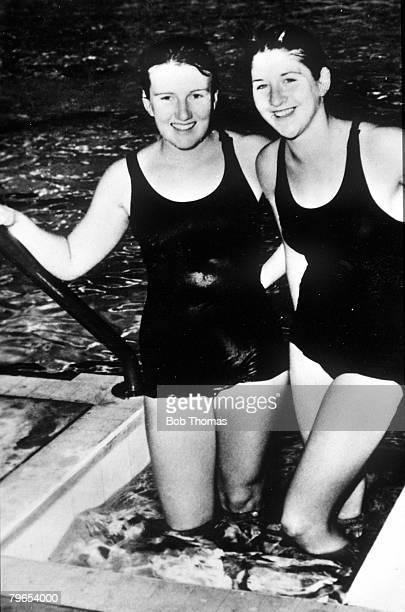 Olympic Games Melbourne Australia Womens Swimming 100 metres Freestyle Gold Medal winner Dawn Fraser is pictured with her Australian teammate...
