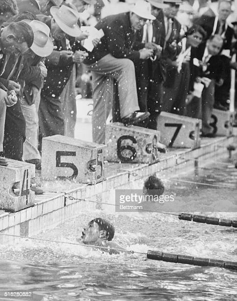 1952 Olympic Games Men's 400 Meters Freestyle Photo shows JC Wardup winning the 1st heat of the men's 400 meters freestyle swimming event at the...