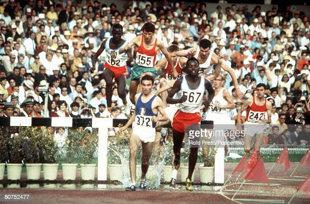 Olympic Games Mexico City Mexico 3000 Metres Steeplechase Kenya's silver medallist Benjamin Kogo leads the race before beaten by teammate Amos Biwott...