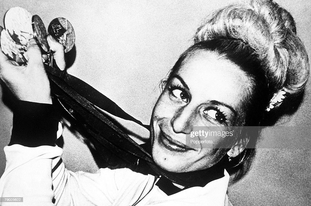 1968 Olympic Games. Mexico City, Mexico. Women's Gymanstics. Czechoslovakian gymnast Vera Caslavska holds the 4 medals she won in the Individual events. : News Photo