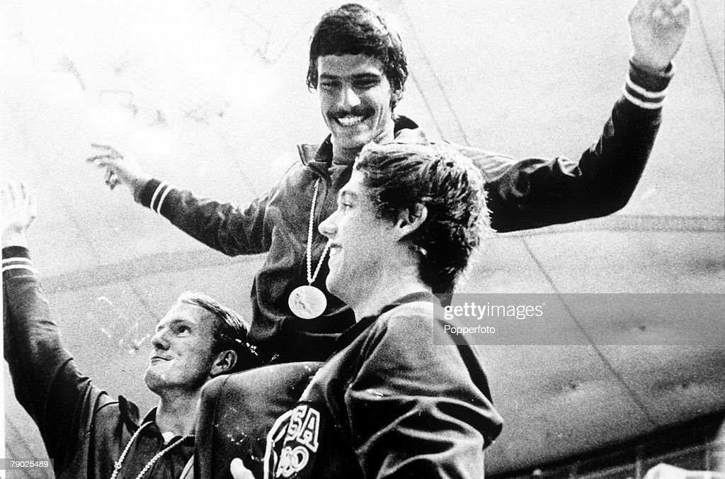 Olympic Games, Munich, West Germany, Men's Swimming, USA's Mark Spitz celebrates with teammates after he won his seventh gold medal in the US medley win.
