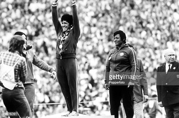 Olympic Games Munich West Germany Women's Discus USSR's gold medallist Faina Melnik celebrates her win as she stands on the podium with Romanian...