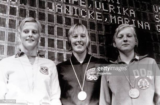 Olympic Games Munich West Germany Women's Springboard Diving USA's gold medal winner Micki King stands on the podium with Swedish silver medal winner...