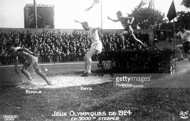 Olympic Games, Paris, France, 3000 Metres Steeplechase, Finland's Ville Ritola leads the race on his way to take the gold medal followed by...