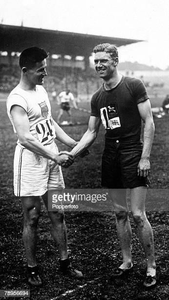 Olympic Games Paris France Men's 110 Metres Hurdles USA's Kinsey who won the gold medal shakes hands with Great Britain's silver medallist Atkinson