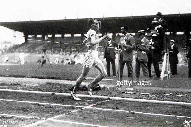 Olympic Games, Paris, France, Men's 1500 Metres Final, Finland's P, Nurmi crosses the line to win the gold medal