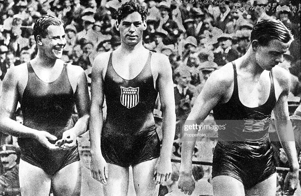 "1924 Olympic Games. Paris, France. Men's 400 Metres Freestyle Swimming. USA's Johnny Weissmuller (C) who won the gold medal in the race with Australia's Andrew ""Boy"" Charlton (R) who took bronze and Swden's A. Borg (L) who took silver. : News Photo"